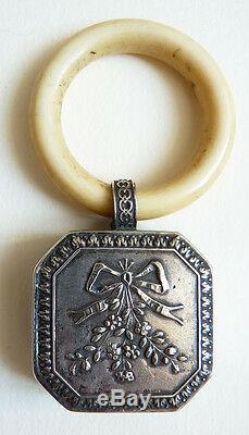 Hochet de bébé en argent massif 19e siècle grelot silver rattle